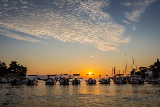 Sunrise picture of the boats in the harbour in Loggos on the lovely island of Paxos by Rick McEvoy photography