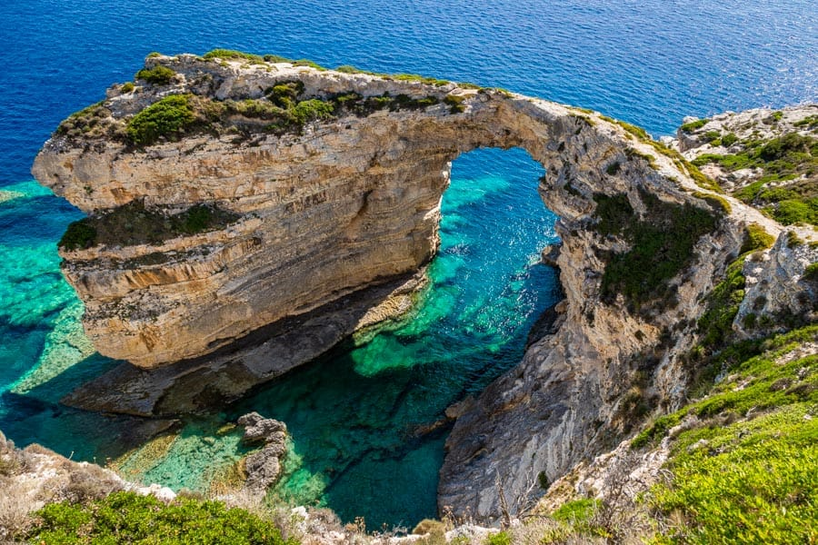 The Tripitos Arch is one of the most popular tourist attractions on the Greek Island of Paxos