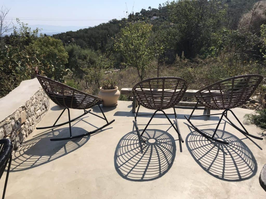 Seats with a view at Averto Day and Night Yard on Paxos